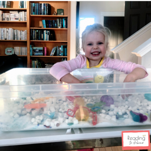 preschooler with queen elsa sensory bin