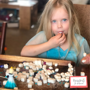 preschooler building a castle for STEM project